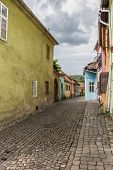Street With Traditional Houses In Sighisoara