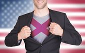 stock photo of alabama  - Businessman opening suit to reveal shirt with state flag  - JPG