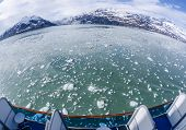 Fish Eye View of Floating Icebergs and Mountains