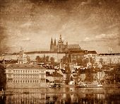 View of Charles bridge over Vltava river and Gradchany (Prague Castle) and St. Vitus Cathedral vinta