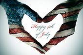 man hands patterned with the flag of the United States forming a heart and the sentence happy 4th of