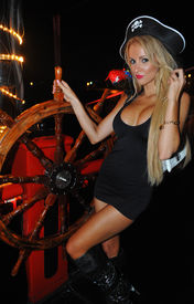 stock photo of playmate  - Model poses sexy at Pirates boat wearing carnival costume - JPG