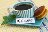 Welcome card with cup of coffee and cookie