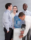 Smiling Multi-ethnic Business People Interacting At A Watercooler