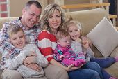 happy young family have fun  with their children at modern living room home indoors