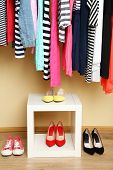 Colorful clothes and shoes in room