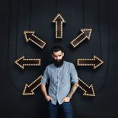 Bearded Man And Lighting Arrows On A Wall