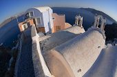 View to caldera in Oia village, Santorini, Greece by fish-eye lens.