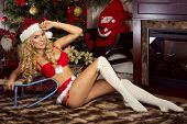 Sensual Blonde Girl In Santa Claus Costume