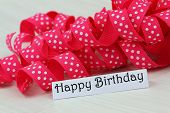 Happy birthday card with pink ribbon