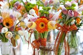 stock photo of florida-orange  - gerbera tulips and mix of summer flowers bouquet for the wedding in the Florida close up - JPG