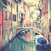 Narrow canal in Venice, Italy. Instagram style filtred image