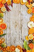Dried fruit and christmas spices on wooden background, space for text