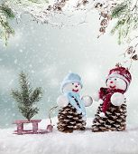 Winter holiday happy snow men with christmas tree on sledge