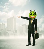 Businessman with dollar sign face