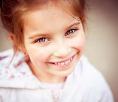 Portrait of a beautiful happy liitle girl close-up