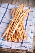 bread sticks grissini torinesi on tablecloth