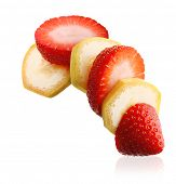 Sliced ripe banana and berry strawberry isolated on white background