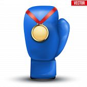 Sport gold medal with ribbon for winning boxing hangs on the gloves.