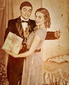 Couple on party drinking champagne .Sepia toned.