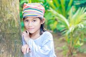 pic of malay  - young beautiful child girl in traditional clothes on natural background - JPG