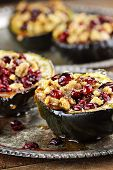 stock photo of acorn  - Acorn squash stuffed and baked with brown sugar walnuts and cranberries ready for holiday dinners - JPG