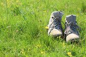 hiking boots on grass