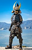 MIYAJIMA,JAPAN-OCT 19, 2014: Japanese man in samurai costume on Oct 19, 2014 in Miyajima, Japan. Samurais were the soldiers in the shogun's army and they were feared all over Japan in the Middle Ages.