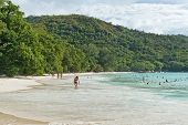 PRASLIN, SEYCHELLES - 21 OCTOBER 2014 - People Enjoying Beach on Anse Lazio in Seychelles on 21 October 2014