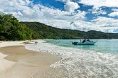 PRASLIN, SEYCHELLES - 21 OCTOBER 2014 - Seascape of Beautiful Anse Lazio Beach in Praslin Island. Captured with Boat and Tourists Having Vacation on 21 October 2014.
