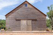 A Wooden Farm Shed/ Wooden Barn And Blue Sky