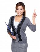 Woman with clipboard and finger point up