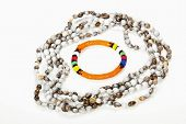 stock photo of zulu  - beaded zulu necklace with bright orange armband - JPG