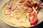 omelet with ham tomato and french fries