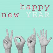 the text happy new year and man hands forming the number 2015 in pop art style