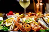 stock photo of clam  - Rich seafood platter with a glass of white wine - JPG