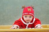 Little Baby Dressed Up As A Reindeer
