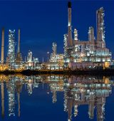 Oil Refinery At Twilight - Petrochemical Industry