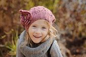 Autumn portrait of cute smiling girl
