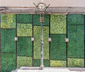 grass wall wall  doors entrance design at Soho Central in Hong Kong