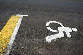 Wheelchair Handicap Sign On Asphalt Road Street Background