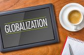Tablet on a wooden desk - Globalization