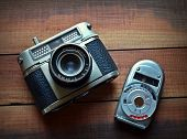 Castellon,Spain.November 26,2014.Old style camera and photometer on a wooden surface