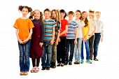 Group of positive children standing together. Isolated over white. Full length portrait.