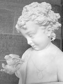 Child with Bird Garden Statue