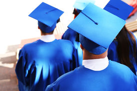 foto of graduation gown  - Graduate students wearing graduation hat and gown - JPG