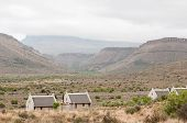 picture of chalet  - Karoo National Park landscape with chalets of the rest camp in the foreground - JPG