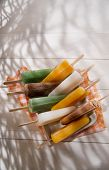 stock photo of popsicle  - Cool off in summer with a break at the base of the fruit popsicles  - JPG