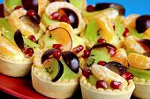 picture of tarts  - Red plate with mini tartes on background - JPG