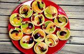 stock photo of tarts  - Plate with mini tart on wooden table - JPG